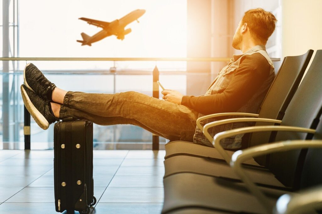 Man at Airport | Remote Working | CyberQ Group